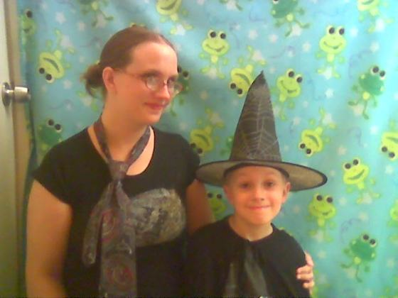 We were wizards attempting to dress as muggles for the QWC.  I made that Weird Sisters shirt myself.